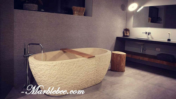chiseled white marble tub