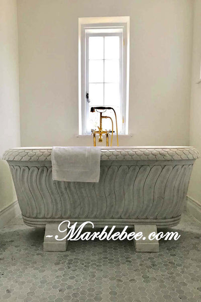 Mermaid stone bathtub