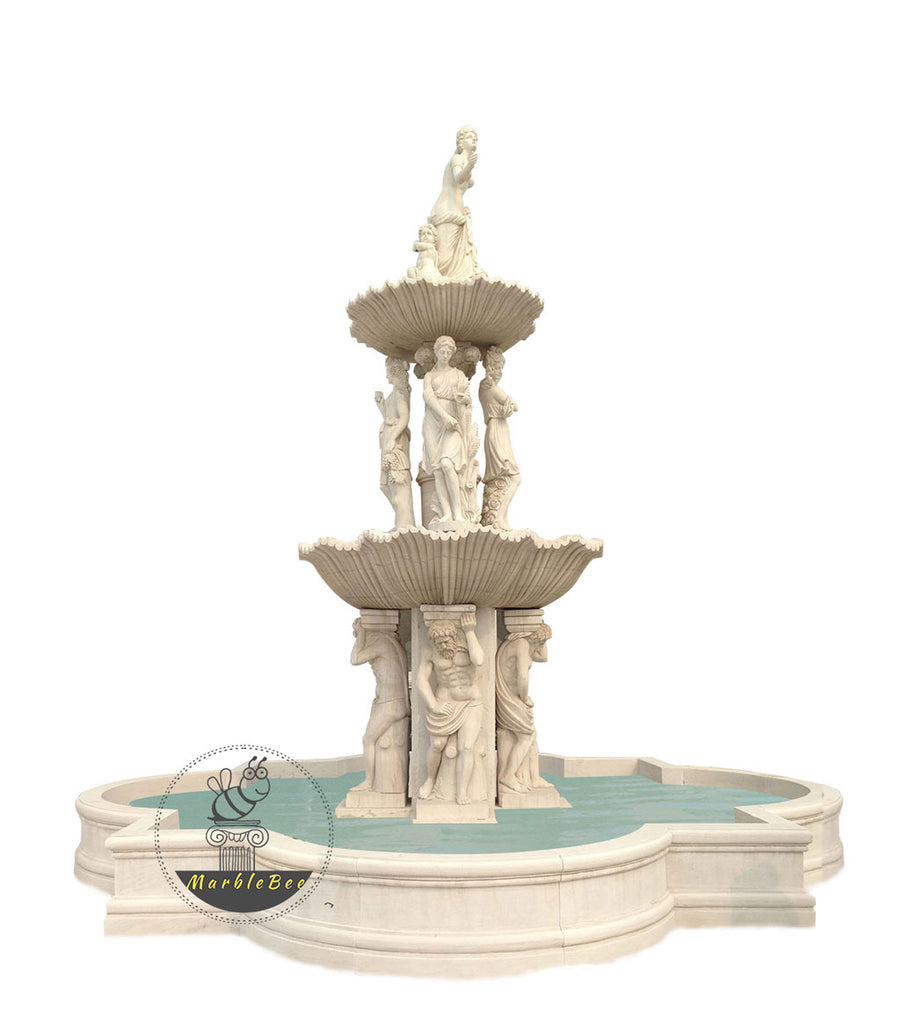 garden tiered fountain with stone statues