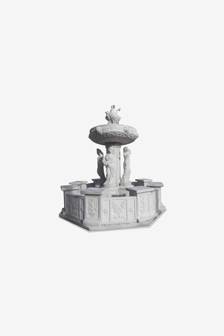 white marble fountain with statues