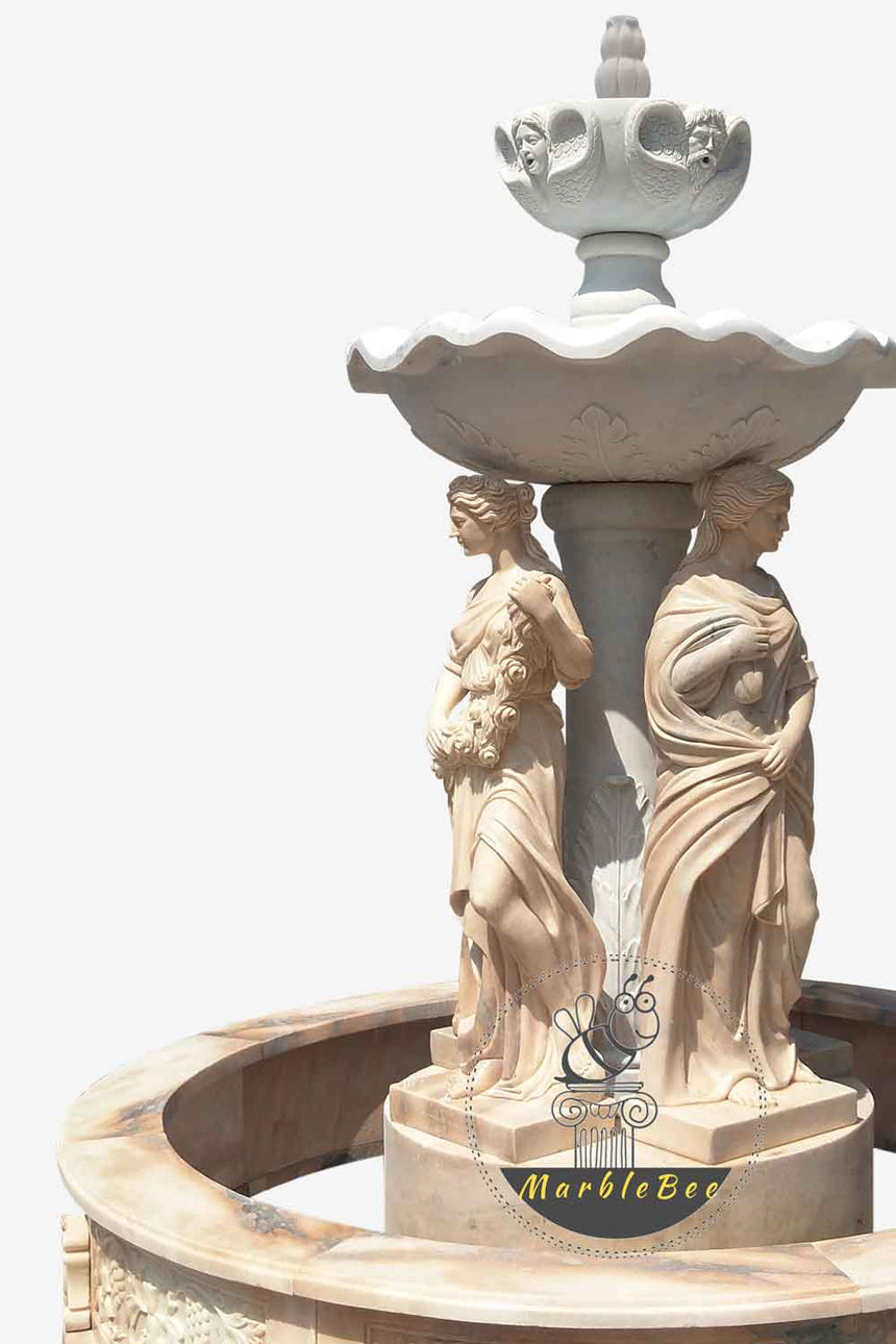 Two tier fountain with greek goddess statues