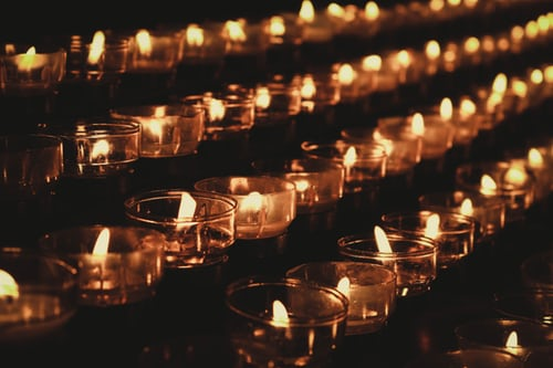 "alt=""candles lit at night in remembrance of those martyred"""