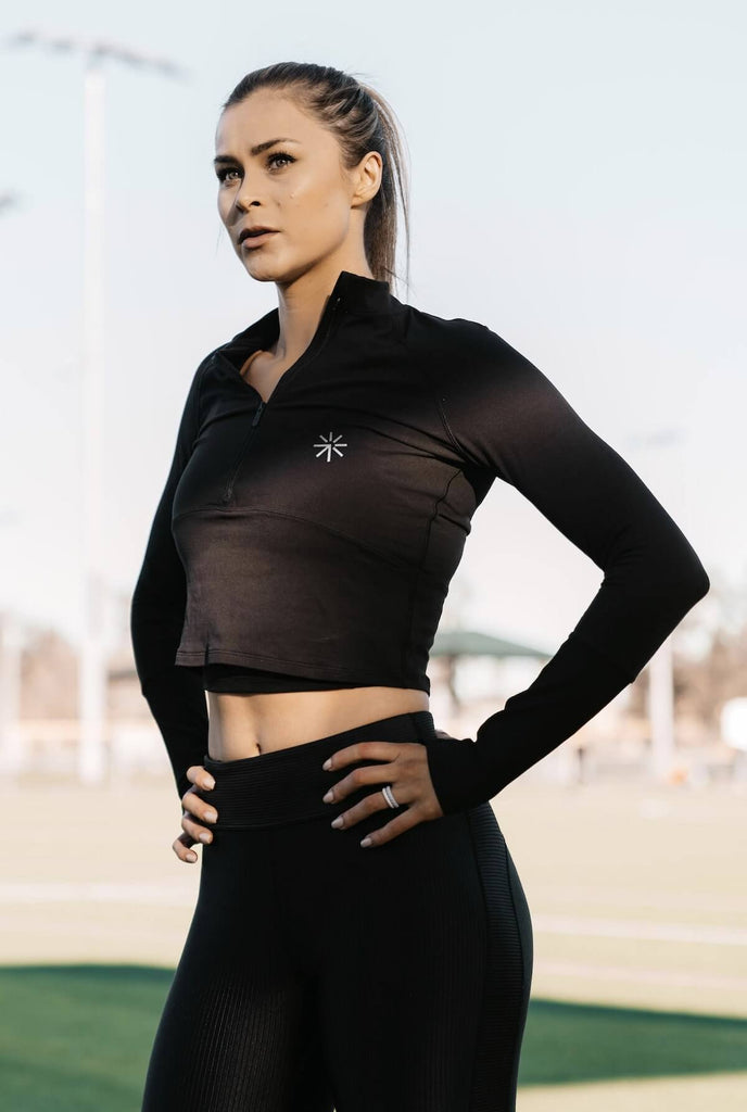 Glute activation exercises: athletic woman standing outdoors