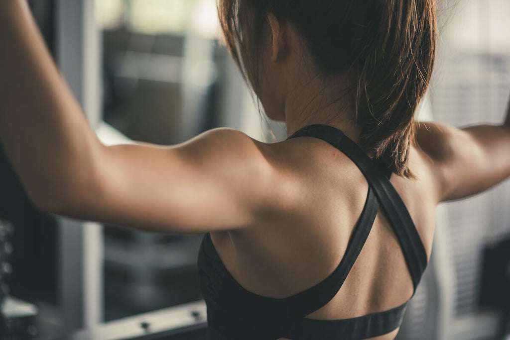 Full body workout for women: close-up of a woman's back muscles