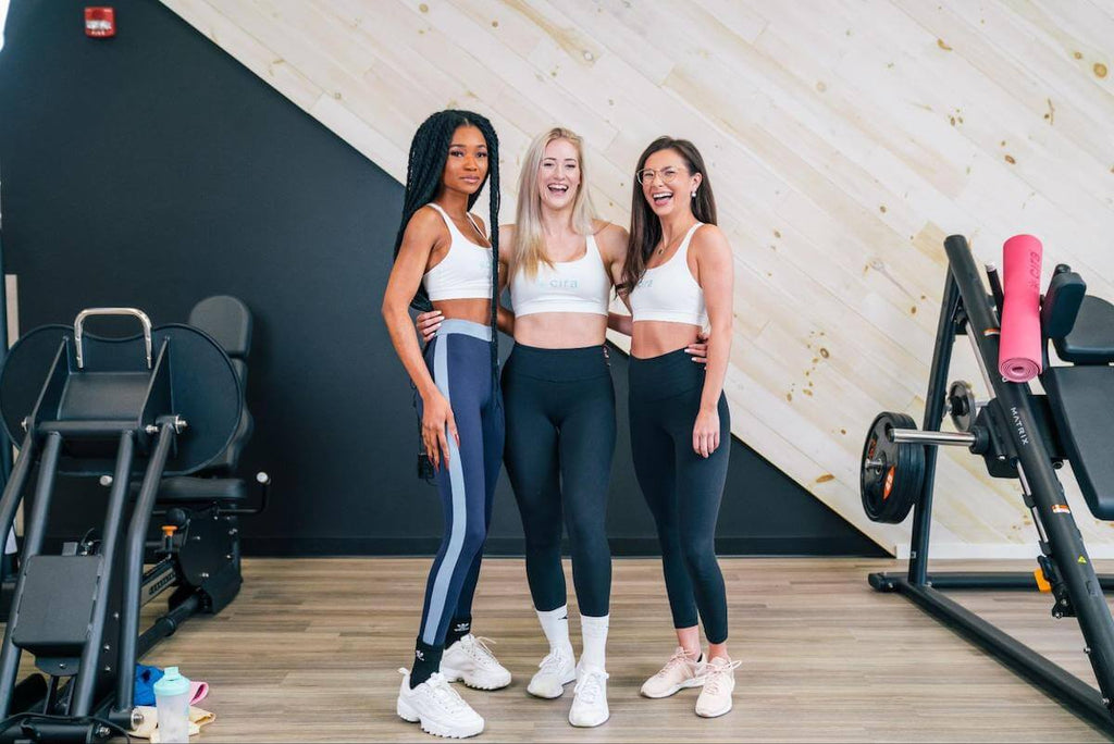 Shoulder workouts for women: group of Cira women at the gym