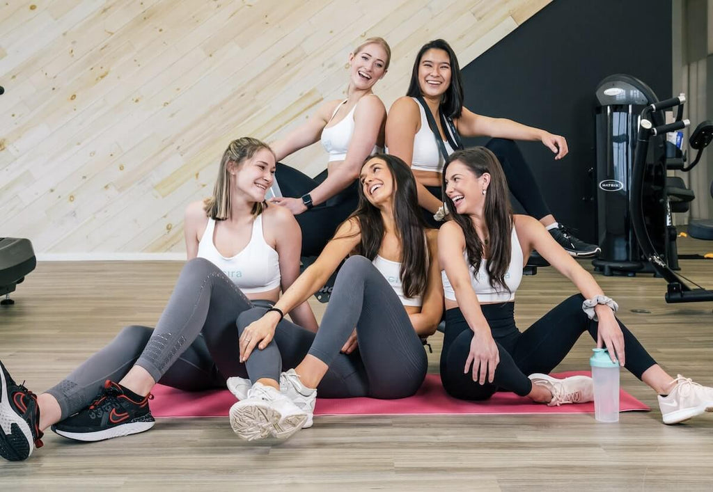 Ab workout for women: group of happy Cira women