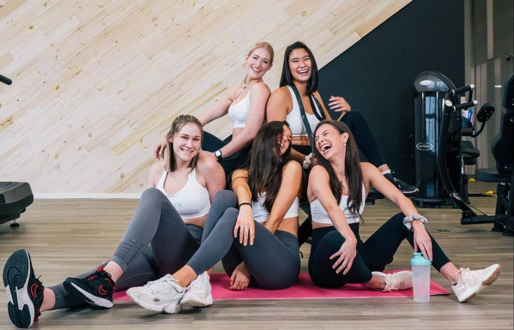 Back workouts for women: happy women at the gym