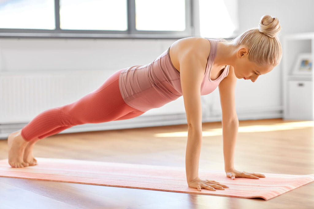 Core exercises for women: woman doing a high plank