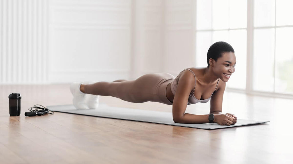 Ab workout for women: woman doing a plank