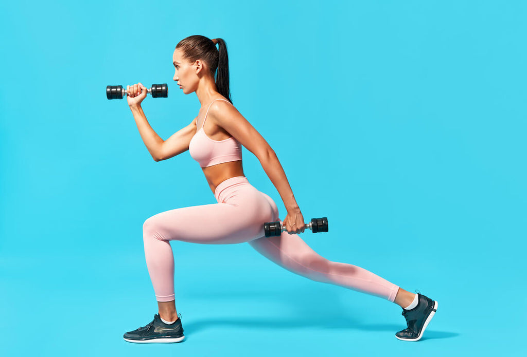 Metabolic workout for women: woman doing lunges with dumbbells