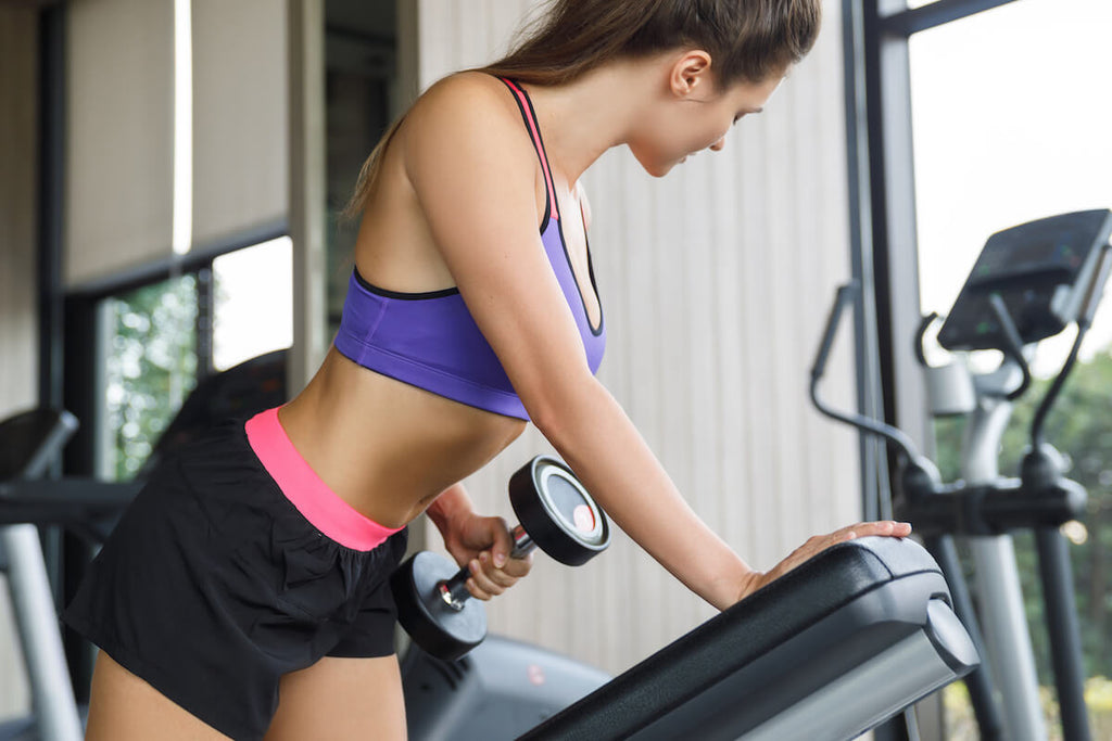 Woman doing one-arm dumbbell row