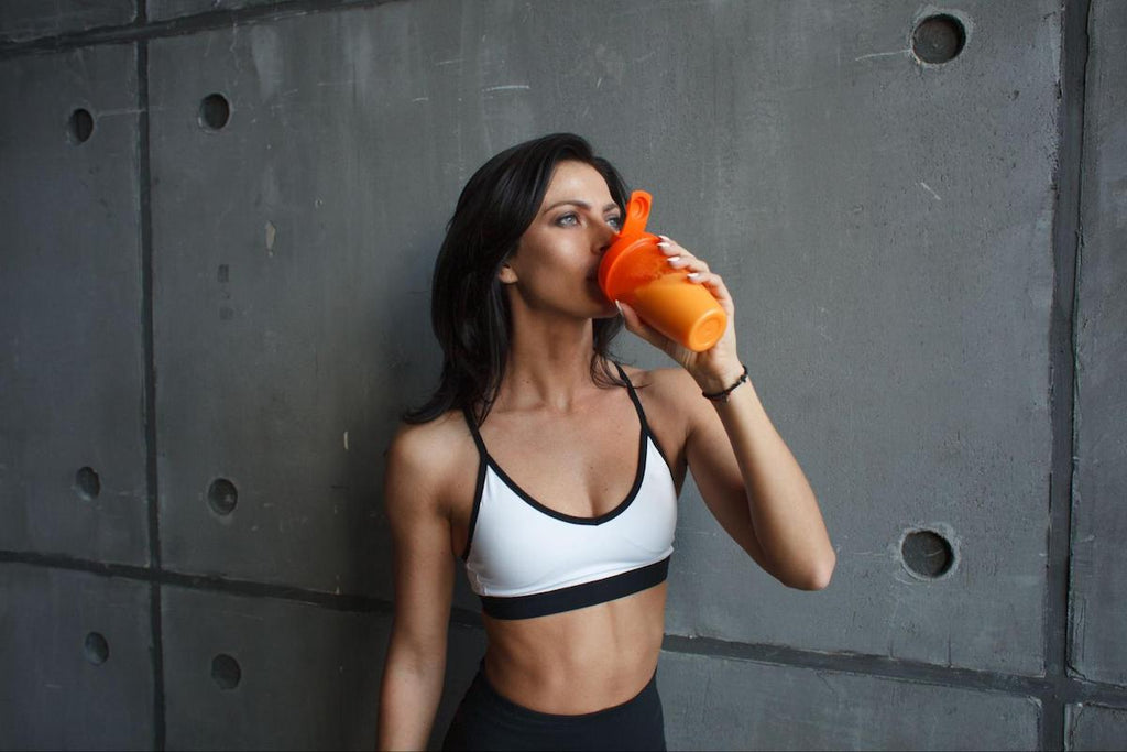 Protein powder for women: woman drinking from her tumbler