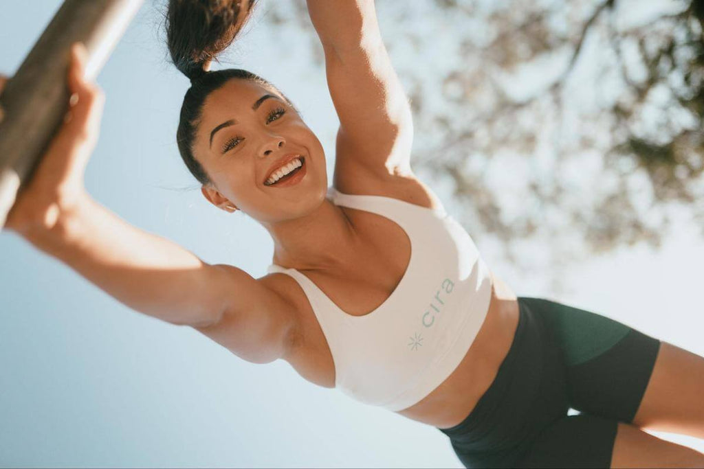 Full body workout for women: happy woman outdoors