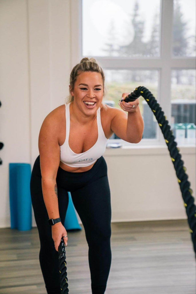 Woman happily exercising with ropes