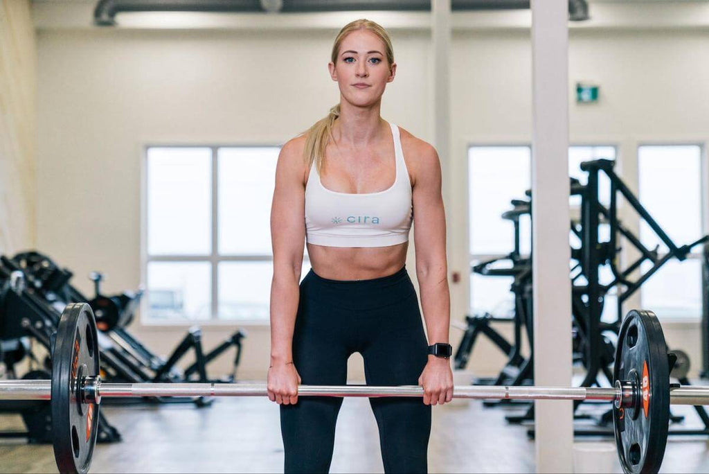 Core exercises for women: woman lifting a barbell