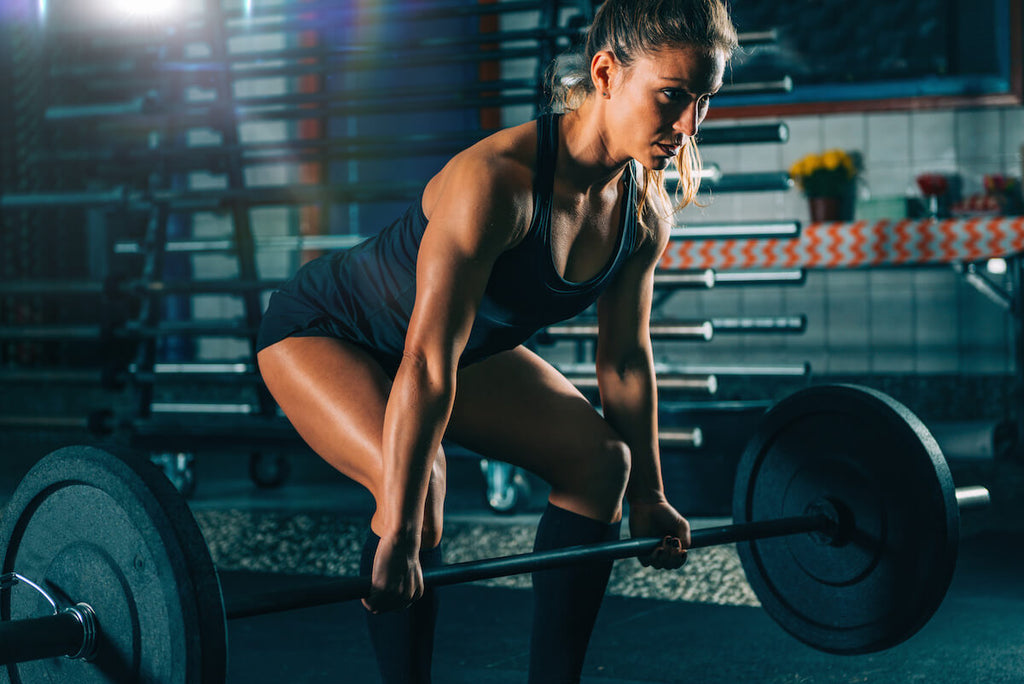 Upper body workout for women: woman lifting heavy barbells