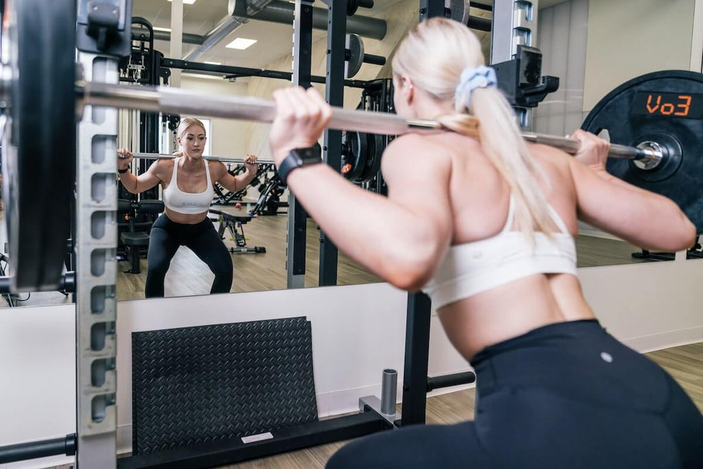Ab workout for women: woman lifting a heavy barbell