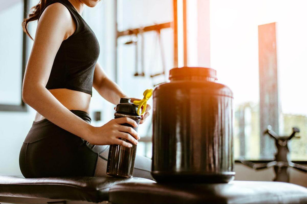 Pre workout for women: woman refilling her tumbler