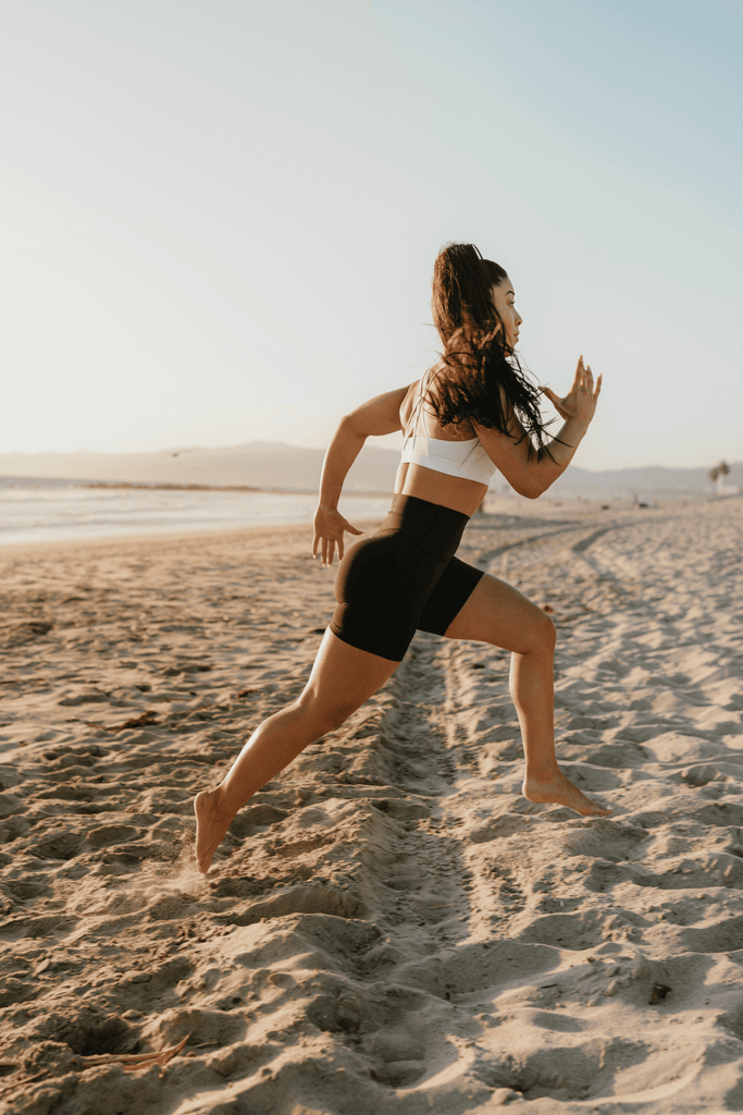 How to lose lower belly fat: woman running on the beach