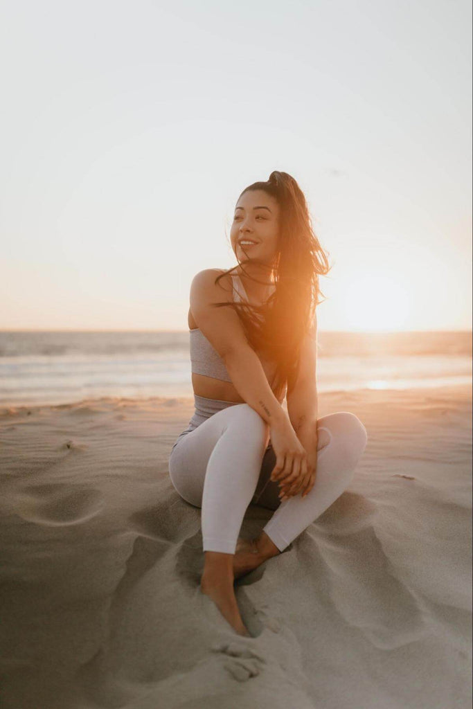 Collagen for hair growth: woman sitting in the sand