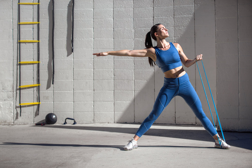Woman using resistance bands in her workout