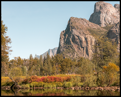 This poster features the Three Brothers rock formation in Yosemite National Park with surrounded by stunning fall colors.