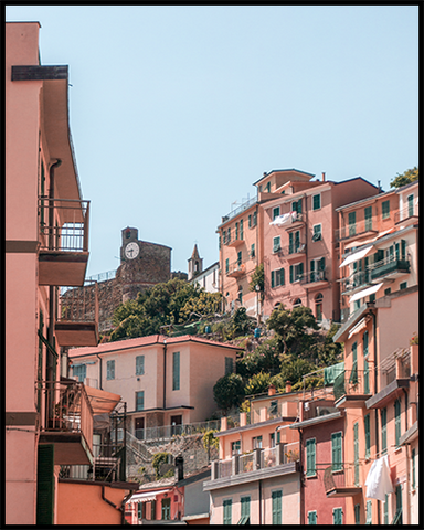 Poster featuring pink houses hill-top houses in Riomaggiore (Italy). Create an inspiring gallery wall with our posters from the Cinque Terre Collection.