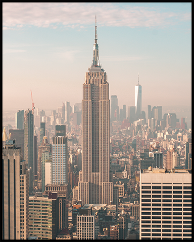 This New York City poster features an unobstructed view of the Empire State Building against a beautiful soft-colored sunrise sky.