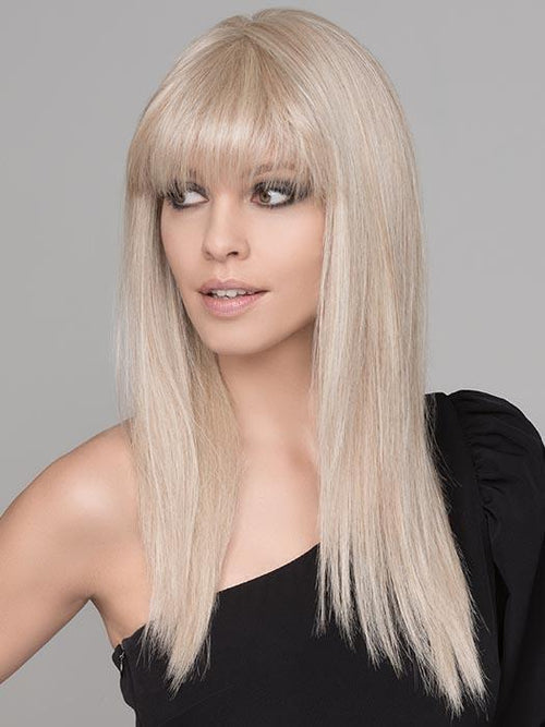 A long, edgy, and super straight synthetic wig with full bangs. The synthetic fiber is of the highest quality and has a natural density that looks and feels like real hair