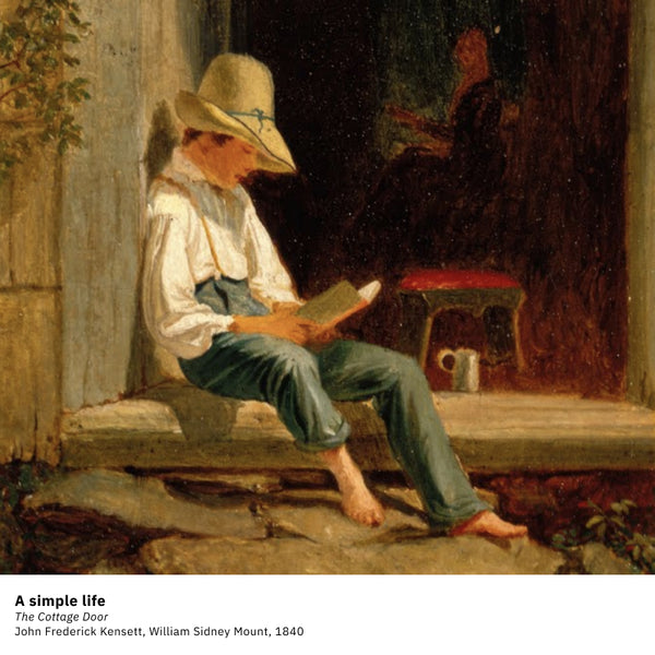 Young boy reading on country porch