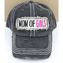 Load image into Gallery viewer, Isn't this mom of girls hat so adorable! This cap is the perfect year-round fashion accessory! Perfect gift for Mom! A Distressed black 100 percent cotton cap. A cute raised fabric applique patch, with mom of girls embroidered on the back, adjustable for the perfect fit!