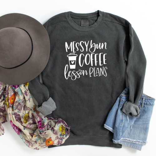 Do you need a great idea for the teacher in your life? Or maybe it's you that would love having this sweatshirt! How cute is this! Messy bun-coffee-lesson plans sweatshirt, shown in a pepper black color!