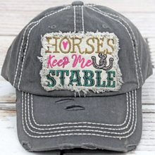Load image into Gallery viewer, Check out this adorable horses keep me stable hat! Shown in a distressed black with a cute applique patch with the quote stated above. All you girls that love your horses need to get this HAT! This cap is the perfect year-round fashion accessory!