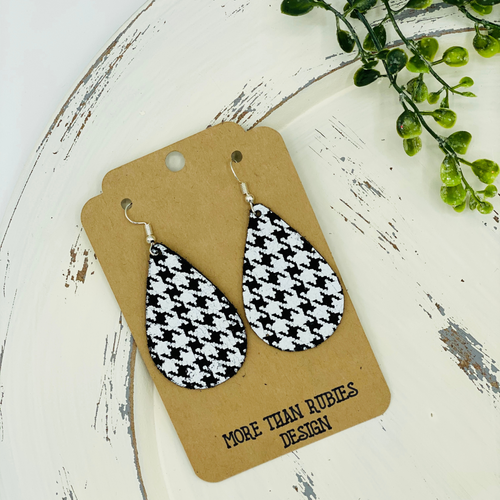 Wow, what a cute pair of leather boho-style teardrop earrings to wear to complete your outfit! Our cute earrings are shown in a black and white houndstooth color made from genuine leather. They are ultra-lightweight and super comfortable. Shop Now!