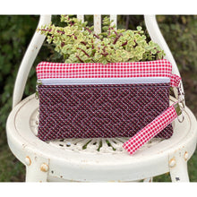 "Load image into Gallery viewer, Our all-purpose zipper clutch ""Ellie"" is a fun and stylish pouch that can be used for many purposes. Such as a coin purse, fabric pencil case, cosmetic bag, or a zippered toiletry bag. It measures approximately 9.5"" X 5.75"" and is made out of beautiful 100% cotton. It is constructed with a high-quality heavy-duty zipper and it is quilted and fully lined for durability. Ellie is machine washable"