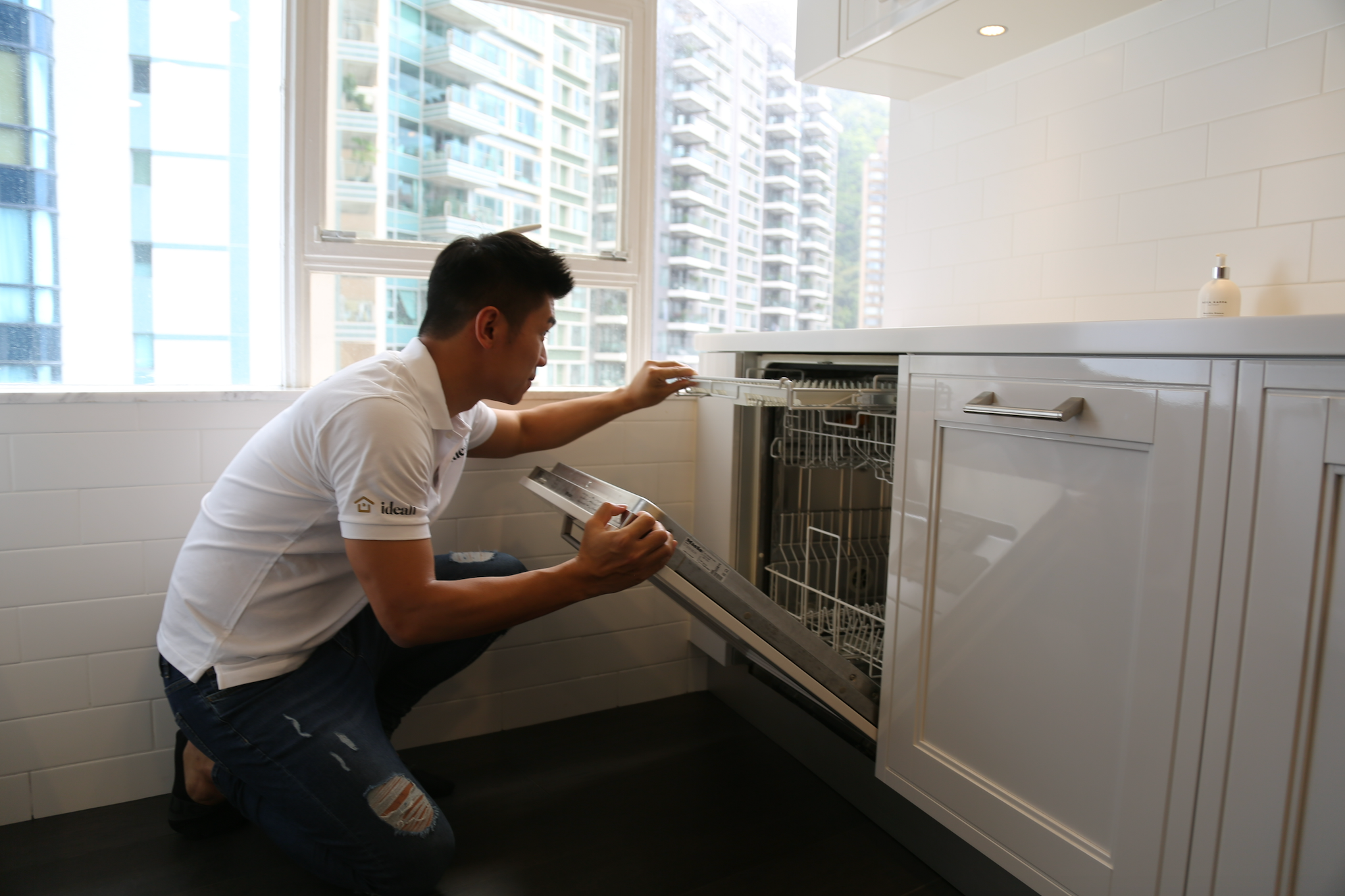 Image of a man installing the dishwasher.
