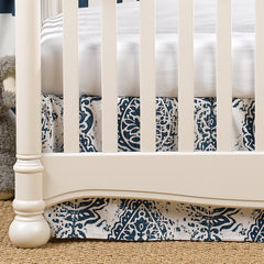 Navy Tristan Crib Skirt and White Crib Sheet