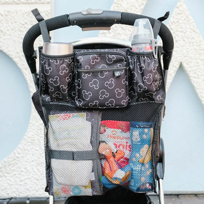 Disney Baby Cups 'N Cargo Stroller Organizer hanging on stroller with accessories in it