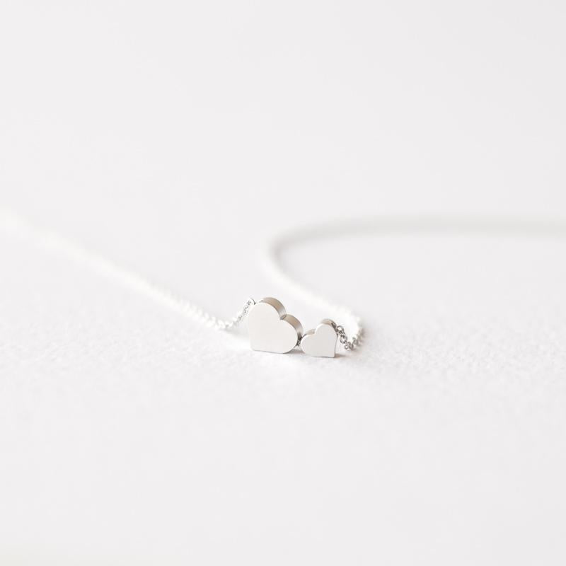 Delicate two silver hearts necklace