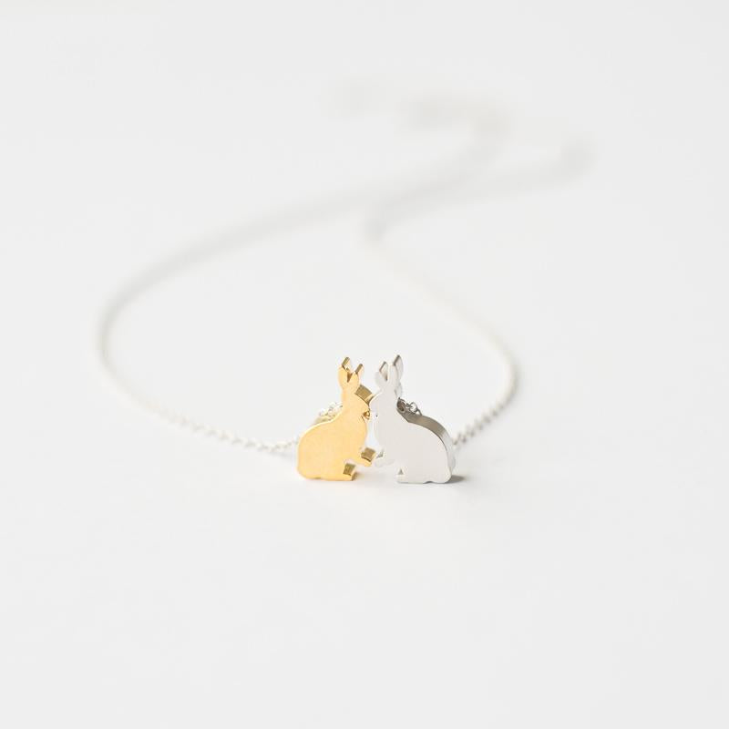 Silver necklace with two rabbits
