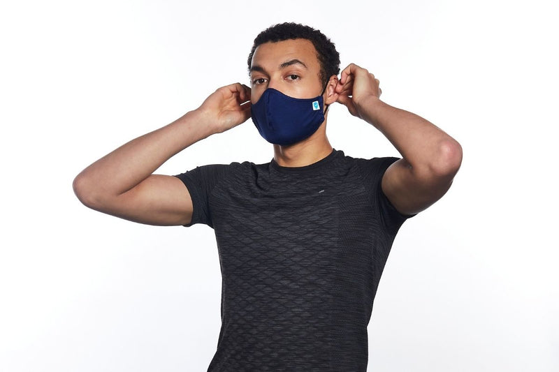 Man wearing a navy face mask by Carrington Textiles