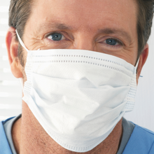 Load image into Gallery viewer, Person showing how fit a Type-1 PPE fabric disposable surgical mask