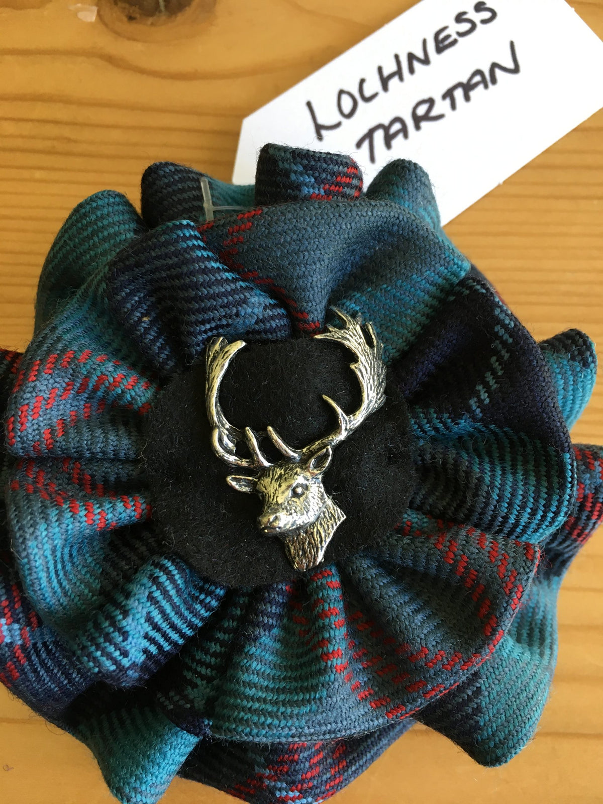 Lochness tartan with Stag Brooch