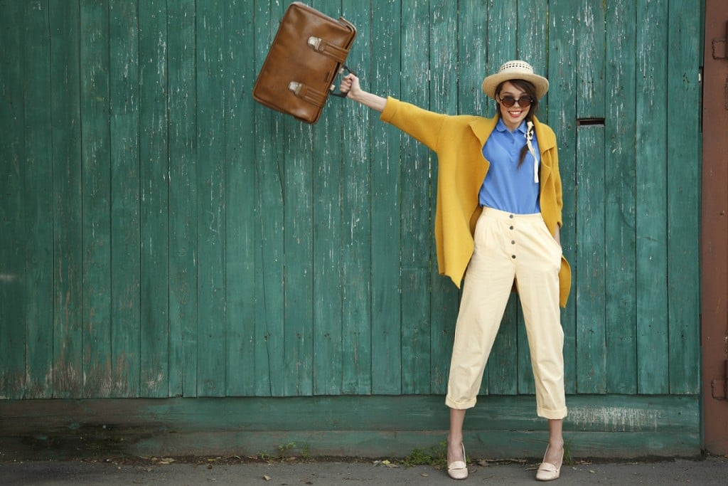 girl in yellow with travel bag - resized copy