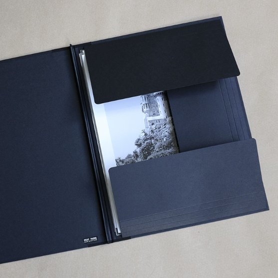 Well styled version of the classic art portfolio, inexpensive and an ideal way of storing and transporting prints, as well as supplying them to clients. They feature tough black texture finish board, with fabric reinforced corners. The portfolios are closed and fastened with strings on each open side.