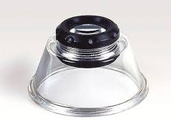 Magnifier for all-round use with color corrected aspherical lens and eyesight correction. Transparent base. Magnification: 10x  Lens diam.: 26 mm (1 in.)  Height: 38 mm (1.5 in.)  Diameter: 66 mm (2.6 in.)
