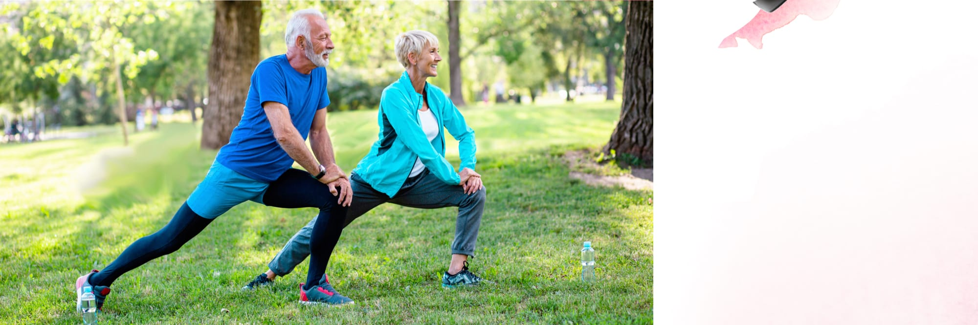 Elderly couple stays healthy and active by practices yoga together outside in a park