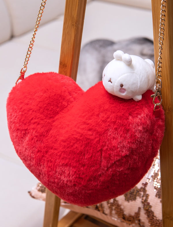 A red heart shaped bag with a cute Molang on top and a zip.