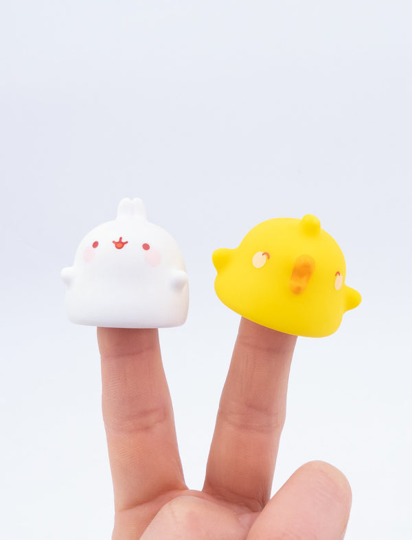 A cute white and yellow finger figures of Molang and Piu Piu.