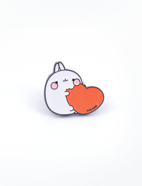 A cute Molang eating a red heart pins.
